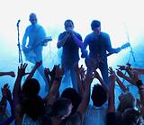 Rock band playing music at a concert