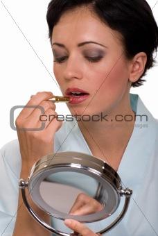 Applying lipstick