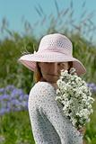 girl in a hat with flowers