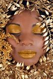 African American Woman Wrapped in Metallic Leaves