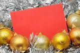 Golden christmas balls and card