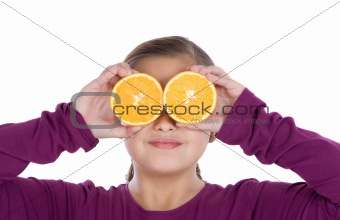 Attractive girl with oranges