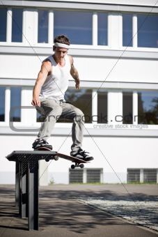 skate making a slide with his skateboard