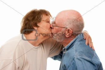 Affectionate Senior Couple Kissing Isolated on a White Background.