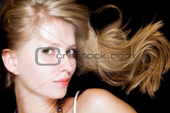Portrait of the beauty blonde. Isolated on black background