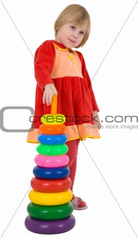 Little girl and plastic toy pyramid