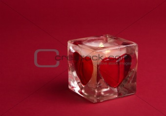Candle with valentines on the red background