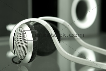 Audio head-phones with speakers at the background