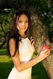 Beautiful girl holding a red apple