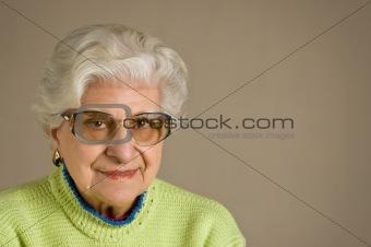 Senior lady portrait,  glasses, with copy space.