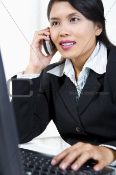 Young Asian businesswoman is on phone