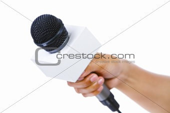 Bare hand holding microphone