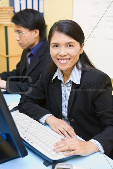 Woman employee is smiling in office