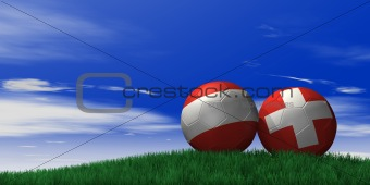 Austria and Switzerland soccer ball on grassand sky background