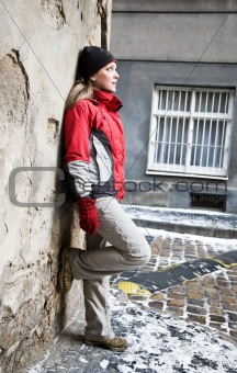 Beauty Woman Staying Against The Wall