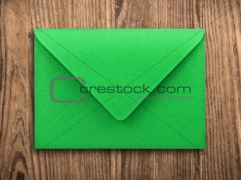 Blank envelope on old table, clipping path.