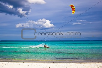 kitesurfer and white sandy beach
