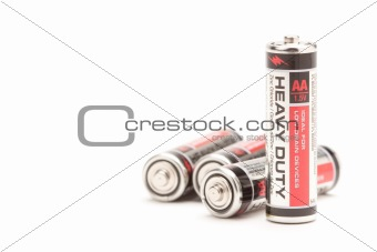 Group of Heavy Duty AA Batteries on a White Background.