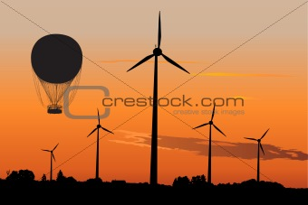 Wind generators and Air Baloon in sunrise