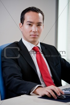 Asian business man using computer