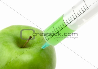 Green apple with syringe inserted