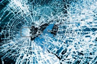 Broken car windshield. Tint blue