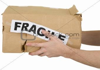 "Crumpled cardboard box with inscription ""fragile"""
