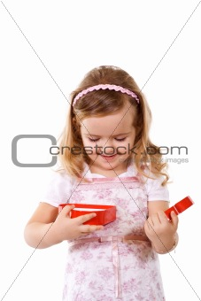 Little girl opening present