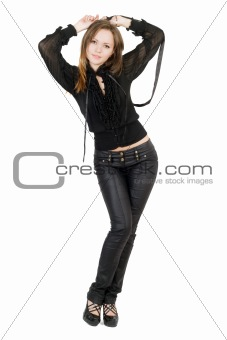 Beautiful girl in black leather pants. Isolated