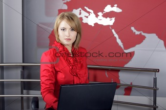 attractive news television presenter in front of the laptop