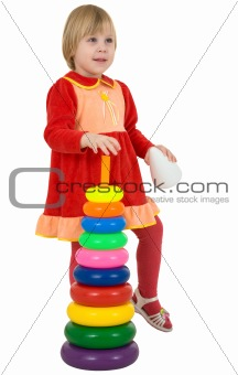 Little girl and toy pyramid