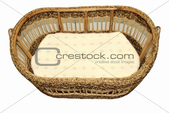 A baby crib made from rattan