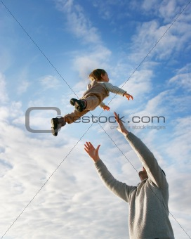 flying boy on sky background