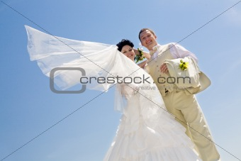 bride with flying viel and groom