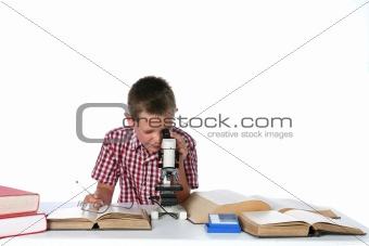 cute young boy looking through a microscope