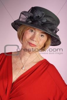 beautiful senior citizen wearing formal hat