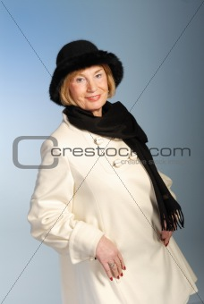 attractive older woman in winter coat & hat