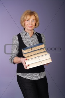 attractive older lady carrying stack of books