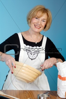 attractive older lady preparing food