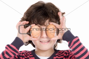 Adorable Child with two eggs on his eyes