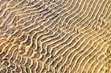 Sand ripples in shallow water