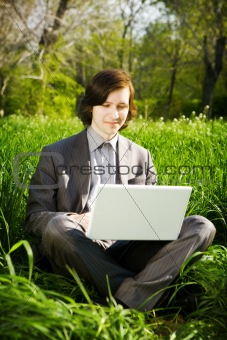 man with laptop outdoors