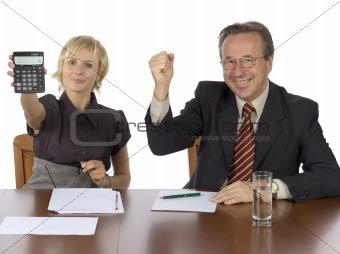 business meeting - woman displays calculator