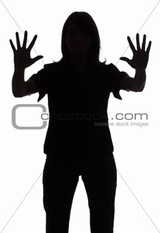 silhouette of woman showing stop