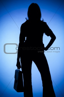 silhouette of woman with suitcase