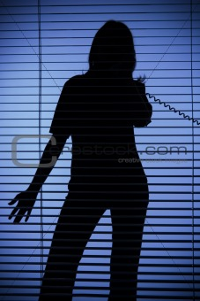 silhouette of woman on the phone (blind)