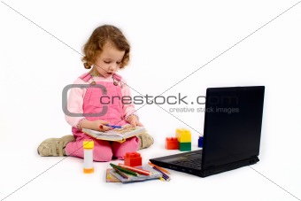 Little girl  with the computer