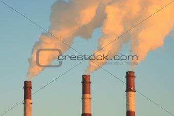 Three smoking chimneys