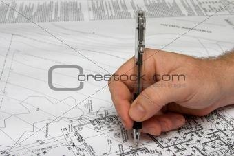 Architect drawing a plan.