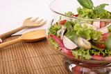 Salad bowl with fresh salad and tomato